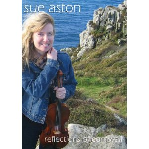 """The beauty of Cornwall through the eyes of Cornish Composer and Violinist Sue Aston. The DVD is a visual treat for anyone in love with the landscape of Cornwall and Celtic Music. The DVD features many of the videos seen on the Classical music channel oMusic (SKY TV) and includes the hits 'The Home Coming' and further tracks from Sue Aston's albums Sacred Landscapes and Inspirational Journey.1. The Home Coming 2.Escape to Freedom 3. Nancy's Garden 4. Elly's Theme 5. Sketches of Newlyn 6. Afternoon Tea 7. MadronSpecial Features Interview with Sue Aston Stills galleryEach DVD Includes a limited FREE personalised signed photograph from Sue Aston 7"""" x 5"""""""
